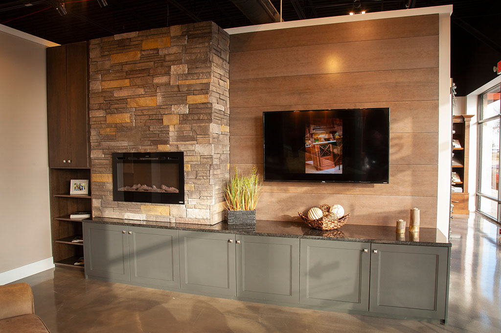 Showroom Tour – Painted green cabinetry with inset fireplace